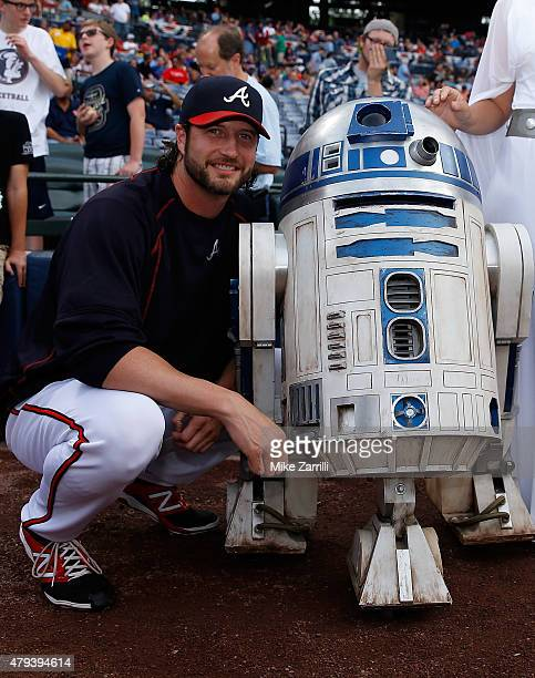 Pitcher Jason Grilli of the Atlanta Braves poses for a picture with R2D2 during pregame Star Wars Night festivities before the game against the...