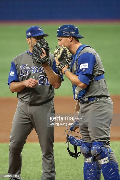 Pitcher Jason Marquis and catcher Ryan Lavarnway of Israel talk on the mound in the third inning of the World Baseball Classic Pool A Game One...