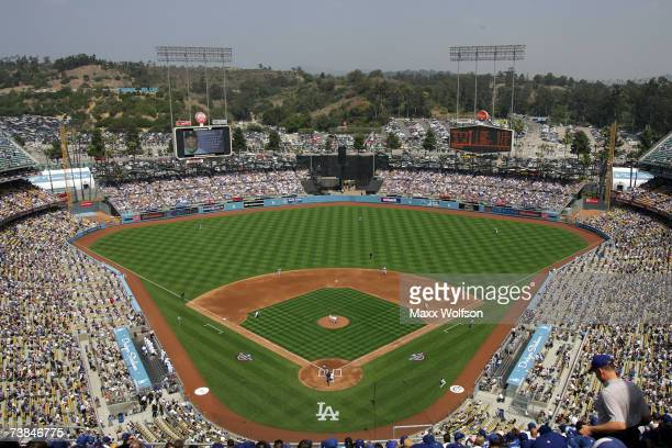 Pitcher Jason Schmidt of the Los Angeles Dodgers throws the first pitch of the game to Willy Taveras of the Colorado Rockies on opening day at Dodger...