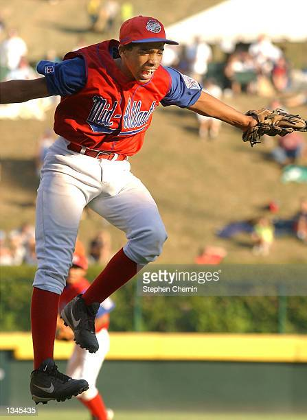 Pitcher Javier Lopez celebrates after Harlem New York defeated Aptos California 52 in the Little League World Series tournament August 20 2002 in...