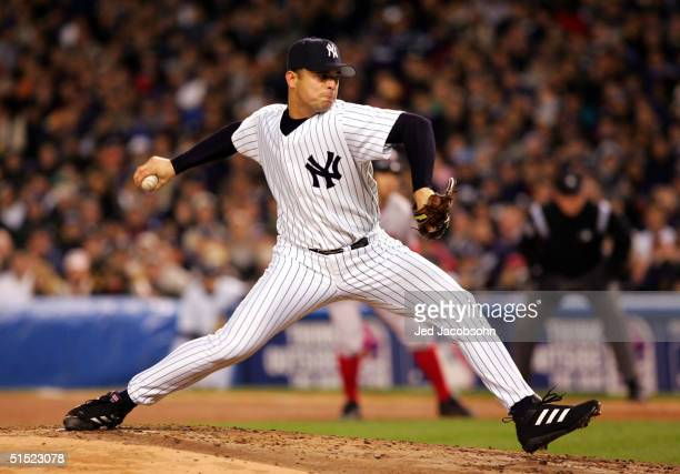 Pitcher Javier Vazquez of the New York Yankees throws a pitch in the second inning against the Boston Red Sox during game seven of the American...