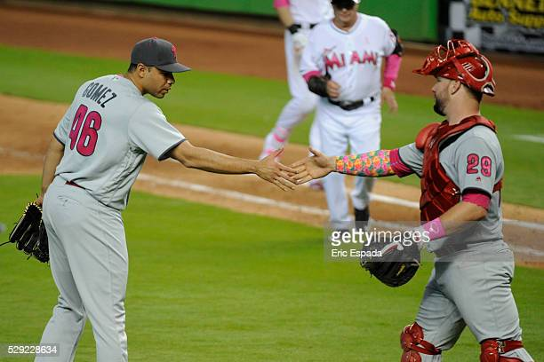 Pitcher Jeanmar Gomez of the Philadelphia Phillies is congratulated by catcher Cameron Rupp of the Philadelphia Phillies after the last out of the...