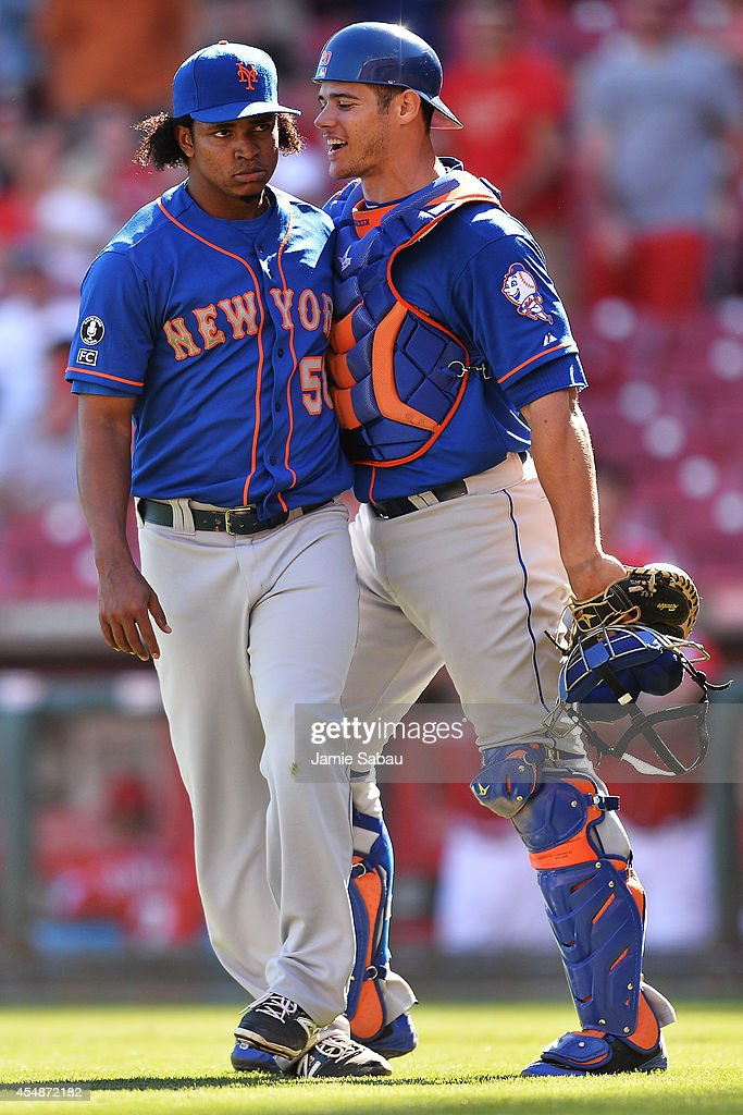 Pitcher Jenrry Mejia #58 of the New York Mets and catcher Anthony Recker #20 of the New York Mets celebrate after defeating the Cincinnati Reds 4-3 at Great American Ball Park on September 7, 2014 in Cincinnati, Ohio.