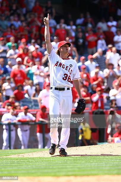 Pitcher Jered Weaver of the Los Angeles Angels of Anaheim reacts after pitching a complete game shutout against the San Diego Padres at Angel Stadium...