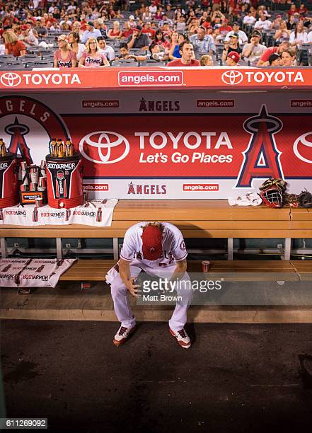 Pitcher Jered Weaver of the Los Angeles Angels of Anaheim sits in the dugout before staring the game against the Oakland Athletics at Angel Stadium...