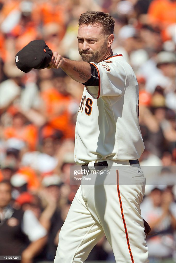 Pitcher Jeremy Affeldt #41 of the San Francisco Giants points to the Colorado Rockies dugout after pitching his final game before retirement as a San Francisco Giant in the sixth inning at AT&T Park on October 4, 2015 in San Francisco, California, during the final day of the regular season. The Rockies won 7-3.