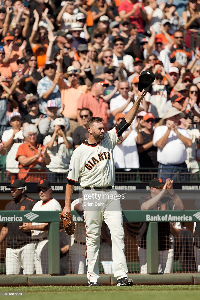 Pitcher Jeremy Affeldt #41 of the San Francisco Giants tips his hat to the crowd after pitching his final game before retirement against the Colorado Rockies in the sixth inning at AT&T Park on October 4, 2015 in San Francisco, California, during the final day of the regular season. The Rockies won 7-3.