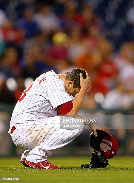 Pitcher Jeremy Hellickson of the Philadelphia Phillies crouches down and reacts after Matt Kemp of the Atlanta Braves hit a three run home run during...