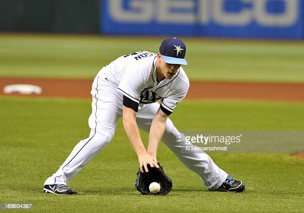 Pitcher Jeremy Hellickson of the Tampa Bay Rays fields an infield ball ini the first inning against the Miami Marlins May 28 2013 at Tropicana Field...