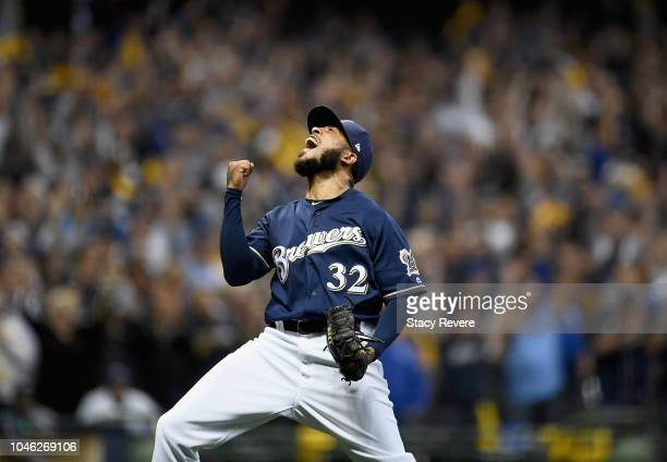 Pitcher Jeremy Jeffress of the Milwaukee Brewers celebrates after the last out of Game Two of the National League Division Series against the...