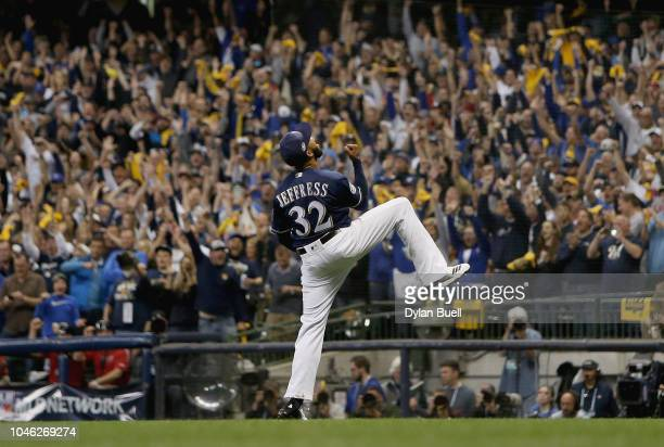 Pitcher Jeremy Jeffress of the Milwaukee Brewers celebrates the last out of Game Two of the National League Division Series against the Colorado...