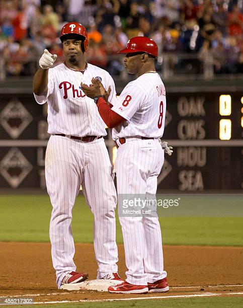 Pitcher Jerome Williams of the Philadelphia Phillies reacts after hitting a two RBI single in the bottom of the fourth inning against the Pittsburgh...