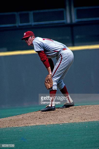 Pitcher Jim Bunning of the Philadelphia Phillies takes the sign from the catcher before delivering a pitch during a 1970 season game against the...