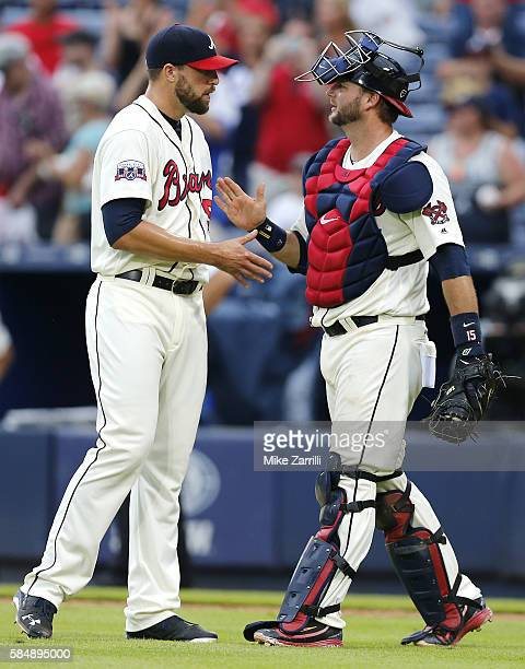 Pitcher Jim Johnson of the Atlanta Braves celebrates with catcher AJ Pierzynski after the game against the Philadelphia Phillies at Turner Field on...