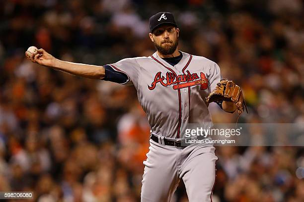 Pitcher Jim Johnson of the Atlanta Braves fields the ball and throws to first base to get the out of Conor Gillaspie of the San Francisco Giants in...