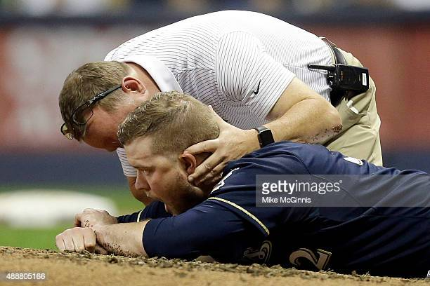 Pitcher Jimmy Nelson lies on the ground after getting hit by a ball off the bat of Tommy Pham of the St Louis Cardinals during the third inning at...