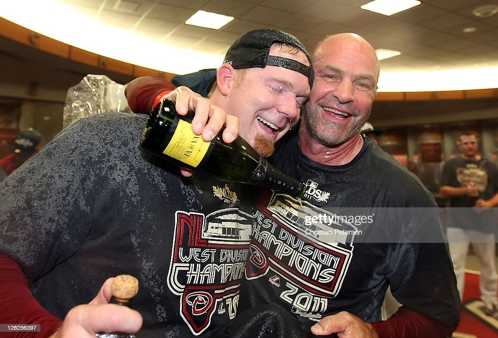 Pitcher J.J. Putz #40 and manager Kirk Gibson of the Arizona Diamondbacks celebrate in the locker room after defeating the San Francisco Giants and clinching the National League West division title at Chase Field on September 23, 2011 in Phoenix, Arizona. The Diamondbacks defeated the Giants 3-1.