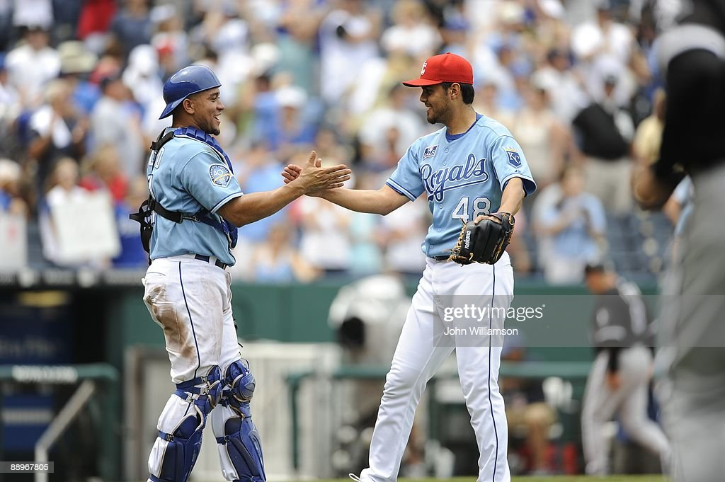 Pitcher Joakim Soria and catcher Miguel Olivo of the Kansas City Royals celebrate a win after the game against the Chicago White Sox at Kauffman Stadium in Kansas City, Missouri on Saturday, July 4, 2009. The Royals defeated the White Sox 6-4.