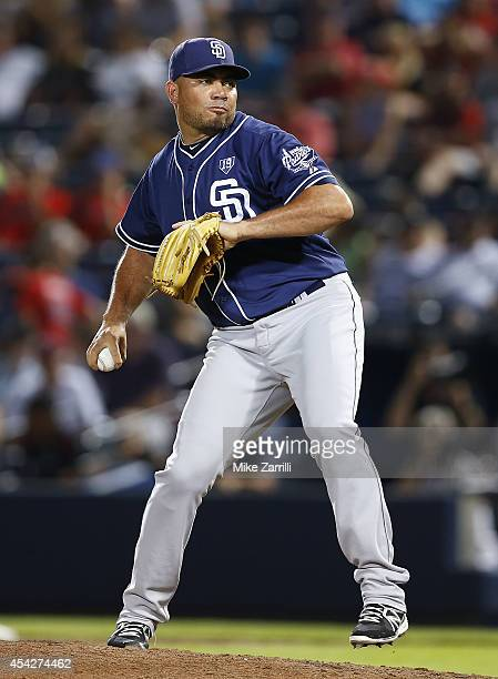 Pitcher Joaquin Benoit of the San Diego Padres throws a pitch during the ninth inning of the game against the Atlanta Braves at Turner Field on July...
