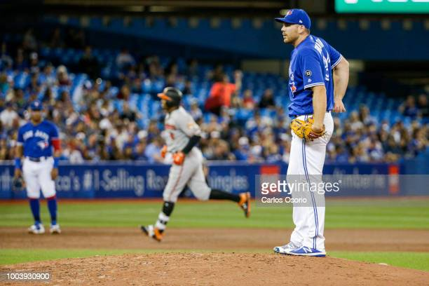 TORONTO ON JULY 22 Pitcher Joe Biagini allows a home run from Jonathan Schoop of the Orioles during the 6th inning of MLB action as the Toronto Blue...