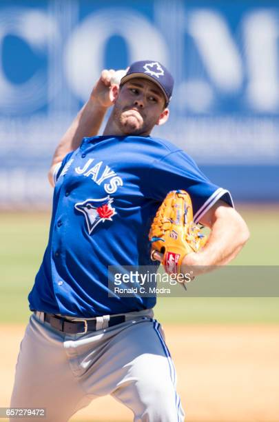 Pitcher Joe Biagini of the Toronto Blue Jays pitches during a spring training game against the Pittsburgh Pirates at LECOM Park on March 19 2017 in...