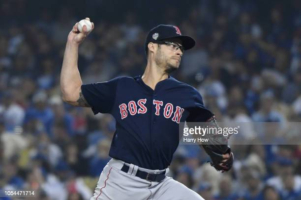 Pitcher Joe Kelly of the Boston Red Sox pitches in relief in the seventh inning of Game Four of the 2018 World Series against the Los Angeles Dodgers...