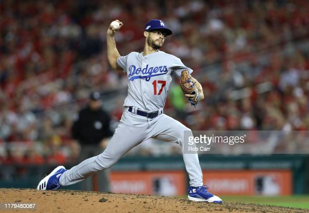 Pitcher Joe Kelly of the Los Angeles Dodgers delivers in the sixth inning of Game 3 of the NLDS against the Washington Nationals at Nationals Park on...