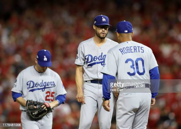 Pitcher Joe Kelly of the Los Angeles Dodgers gets a visit by manager Dave Roberts and is pulled in the sixth inning of Game 3 of the NLDS against the...