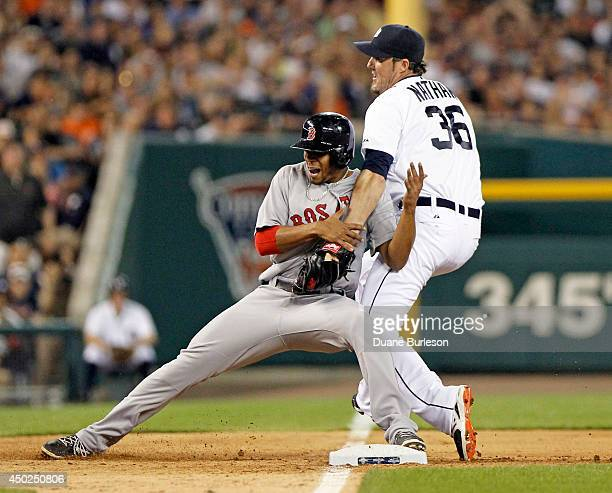 Pitcher Joe Nathan of the Detroit Tigers is too late to make the tag on Xander Bogaerts of the Boston Red Sox stealing third base during the ninth...