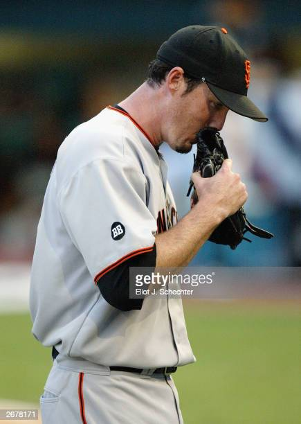 Pitcher Joe Nathan of the San Francisco Giants smells his glove after being taken out of the game against the Florida Marlins during the National...