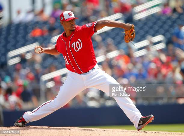 Pitcher Joe Ross of the Washington Nationals delivers a pitch against the Houston Astros during the first inning of a spring training baseball game...