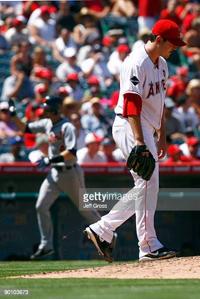 Pitcher Joe Saunders of the Los Angeles Angels of Anaheim looks down after giving up a tworun home run to Adam Everett of the Detroit Tigers in the...