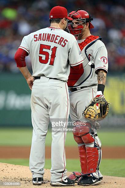 Pitcher Joe Saunders talkes with Mike Napoli of the Los Angeles Angels of Anaheim on July 23 2010 at Rangers Ballpark in Arlington Texas