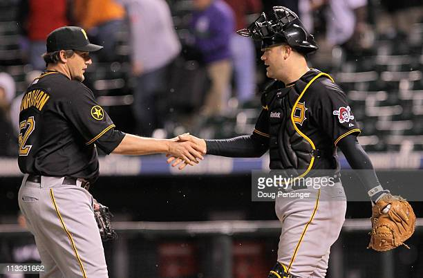 Pitcher Joel Hanrahan and catcher Chris Snyder of the Pittsburgh Pirates celebate their victory over the Colorado Rockies at Coors Field on April 29...
