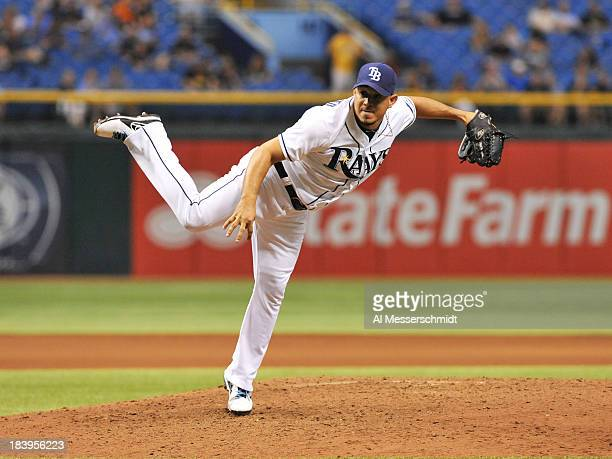 Pitcher Joel Peralta of the Tampa Bay Rays throws in relief against the Texas Rangers September 18 2013 at Tropicana Field in St Petersburg Florida