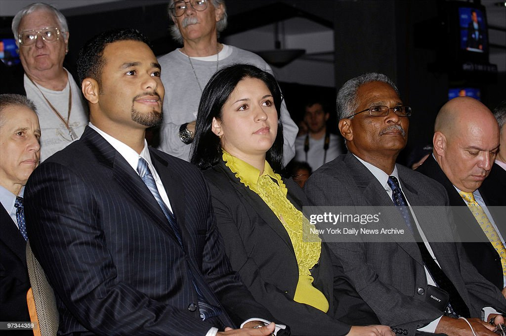 Pitcher Johan Santana (left) sits alongside wife Yasmine Gar : News Photo