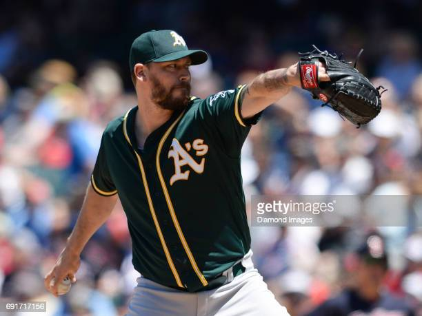 Pitcher John Axford of the Oakland Athletics throws a pitch during a game on June 1 2017 against the Cleveland Indians at Progressive Field in...