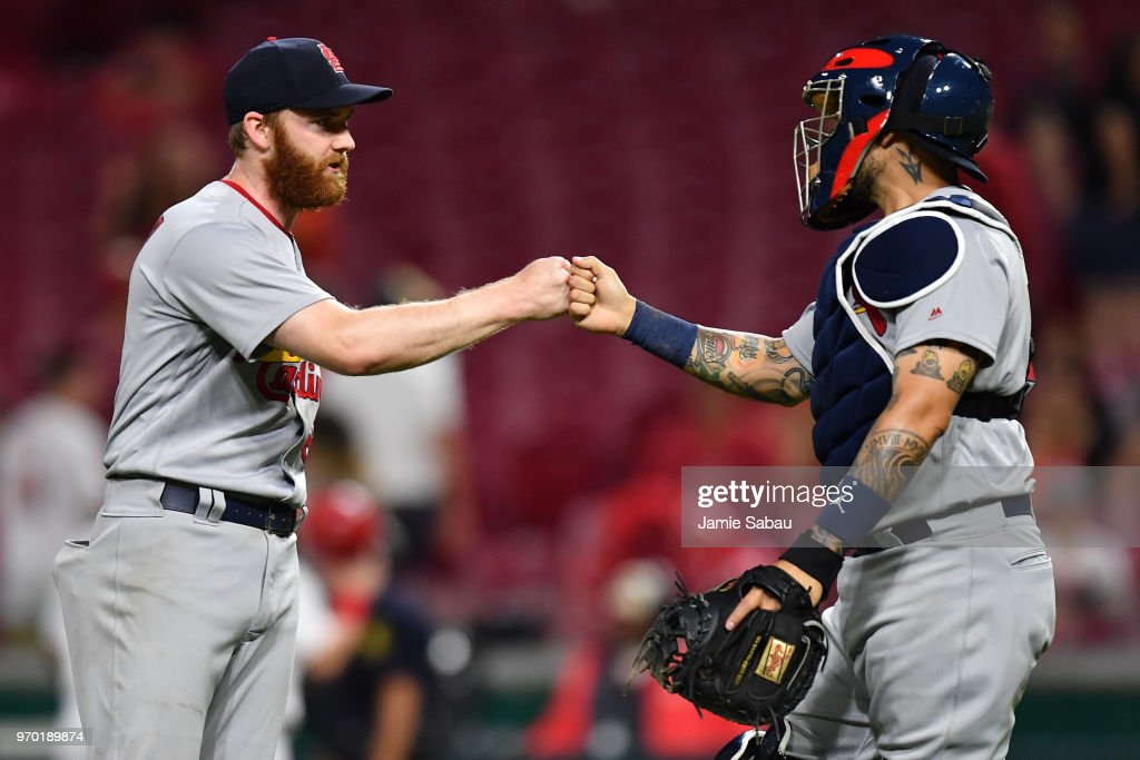 Pitcher John Brebbia #60 of the St. Louis Cardinals celebrates with catcher Yadier Molina #4 of the St. Louis Cardinals after striking out the last Cincinnati Reds batter in the 10th inning at Great American Ball Park on June 8, 2018 in Cincinnati, Ohio. St. Louis defeated Cincinnati 7-6 in 10 innings.