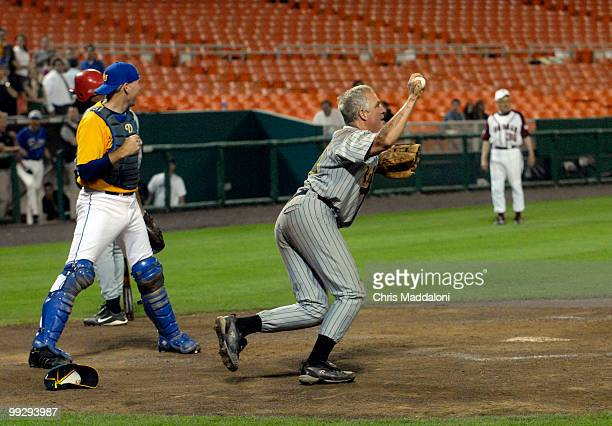 GOP pitcher John Shimkus catches William Jefferson's pop fly ball after the catcher Gresham Barrett missed the catch at the 45th Annual Roll Call...
