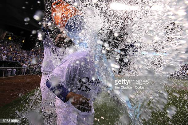 Pitcher Johnny Cueto Kansas City Royals is drenched with the gatorade bucket by team mate Salvador Perez after Cueto pitched a nine inning shut out...