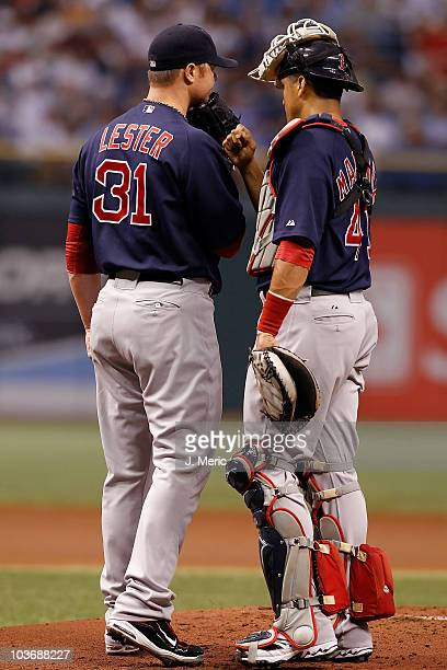 Pitcher Jon Lester and catcher Victor Martinez of the Boston Red Sox have a conversation at the mound against the Tampa Bay Rays during the game at...