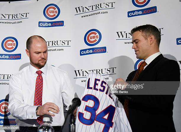 Pitcher Jon Lester is presented with a Cubs jersey by Chicago Cubs President Theo Epstein during an introduction press conference on December 15 2014...