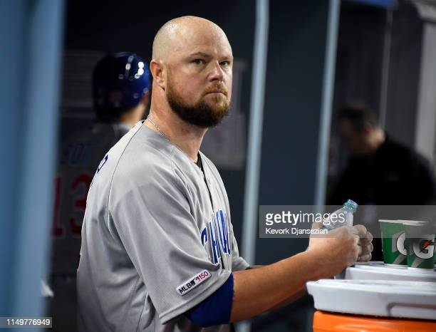 Pitcher Jon Lester of the Chicago Cubs reacts in the dugout after giving up three tworun home runs to the Los Angeles Dodgers before coming out of...