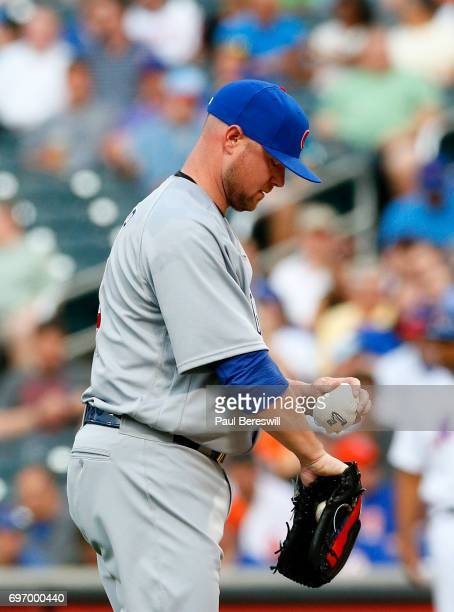 Pitcher Jon Lester of the Chicago Cubs uses the rosin bag as he prepares to pitch in an MLB baseball game against the New York Mets on June 13 2017...