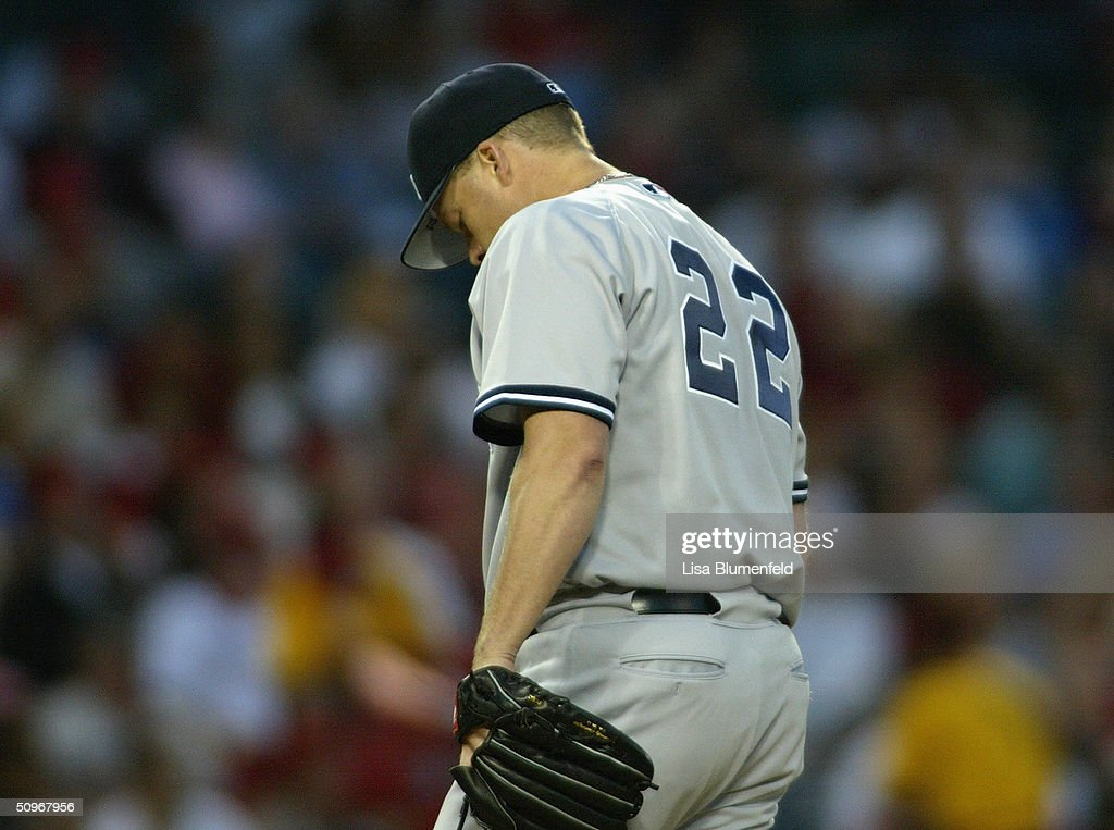 Pitcher Jon Lieber #22 of the New York Yankees prepares to throw against the Anaheim Angels at Angel Stadium on May 19, 2004 in Anaheim, California. The Yankees won 4-2.