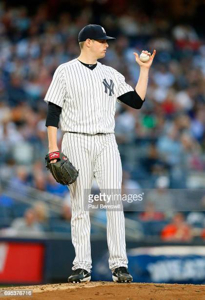 Pitcher Jordan Montgomery of the New York Yankees gestures to the outfield in an MLB baseball game against the Baltimore Orioles on June 9 2017 at...