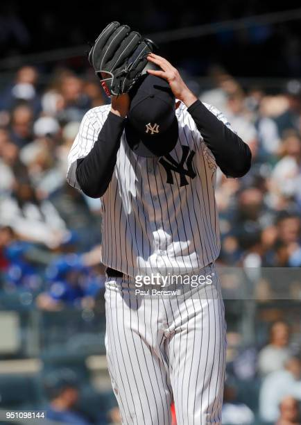 Pitcher Jordan Montgomery of the New York Yankees reacts in an MLB baseball game against the Toronto Blue Jays on April 21 2018 at Yankee Stadium in...