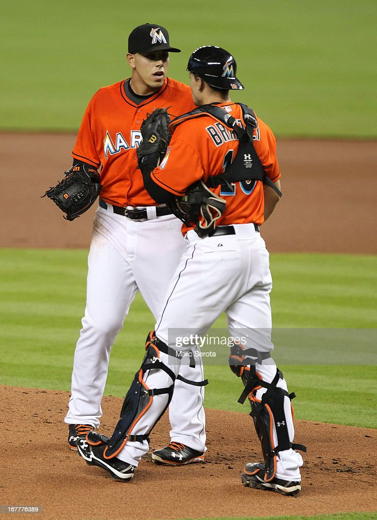 Pitcher Jose Fernandez #16 of the Miami Marlins chats with catcher Rob Brantly #19 against the New York Mets in the third inning at Marlins Park on April 29, 2013 in Miami, Florida.
