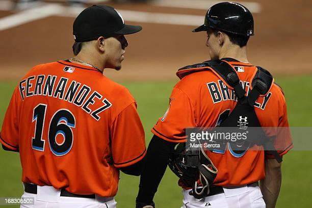 Pitcher Jose Fernandez of the Miami Marlins chats with catcher Rob Brantly against the New York Mets in the third inning at Marlins Park on April 29...