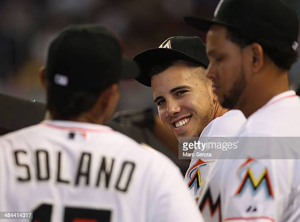 Pitcher Jose Fernandez of the Miami Marlins watches from the duggout during a game against the Colorado Rockies at Marlins Park on April 3 2014 in...